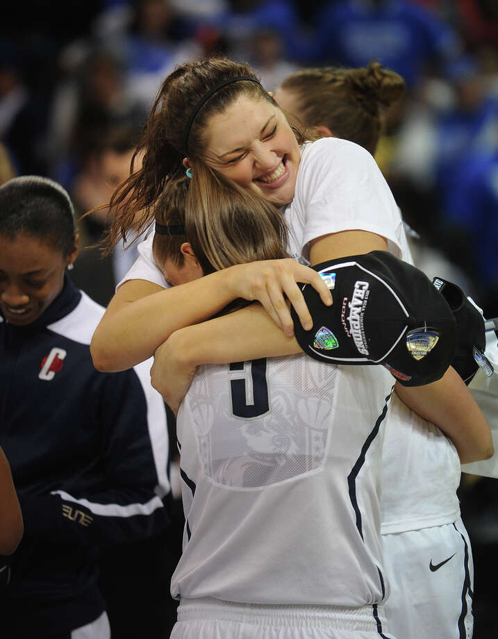 UConn's Stefanie Dolson, facing, hugs teammate Caroline Doty following their 83-53 victory over Kentucky in the elite eight round of the NCAA Women's Basketball Tournament at the Webster Bank Arena in Bridgeport, Conn. on Monday, April 1, 2013. Photo: Brian A. Pounds / Connecticut Post