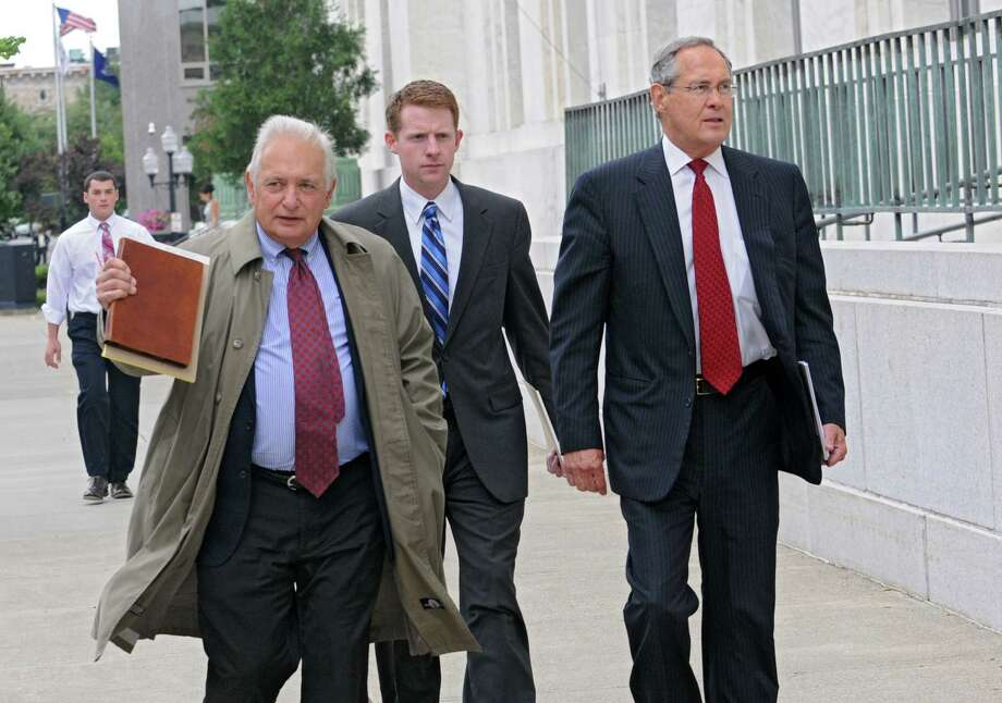 Attorneys for Joe Bruno, William Dreyer, left, and E. Stewart Jones, right, arrive at the James T. Foley U.S. Courthouse on Broadway Tuesday afternoon, Aug. 13, 2013, for a status hearing for the former State Senate Majority Leader in Albany, N.Y. (Lori Van Buren / Times Union) Photo: Lori Van Buren / 00023498A