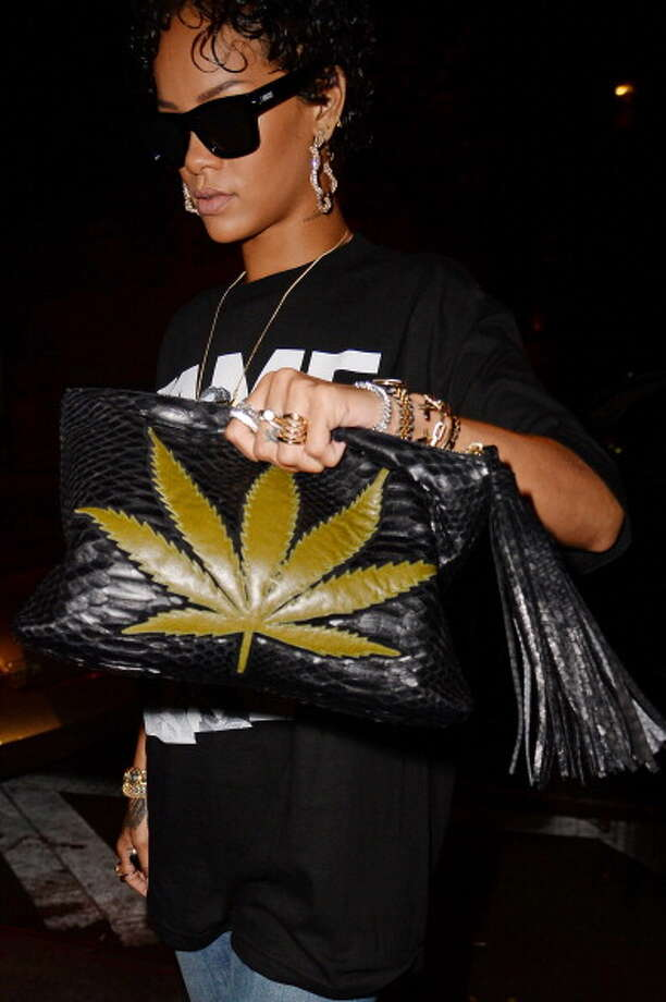 Rihanna is frequently spotted, or posts photos of herself, either smoking marijuana or sporting pro-pot items like this purse. She advocates for pot's legalization.  (Photo by Josiah Kamau/BuzzFoto/FilmMagic) Photo: Josiah Kamau, BuzzFoto/FilmMagic