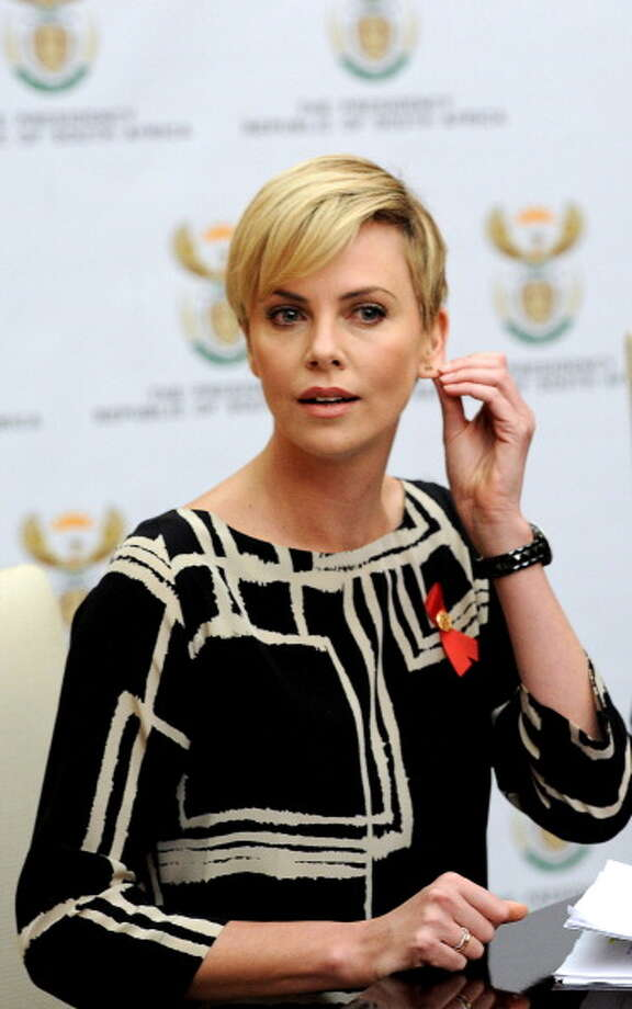 South African-born Hollywood actress and UN Messenger of Peace Charlize Theron was spotted supposedly smoking marijuana out of an apple and then erupting into giggles in 2002. Those photos can be seen here: http://www.hollywire.com/2009/11/top-50-celebs-who-go-green (Photo credit: STEPHANE DE SAKUTIN/AFP/Getty Images) Photo: STEPHANE DE SAKUTIN, AFP/Getty Images
