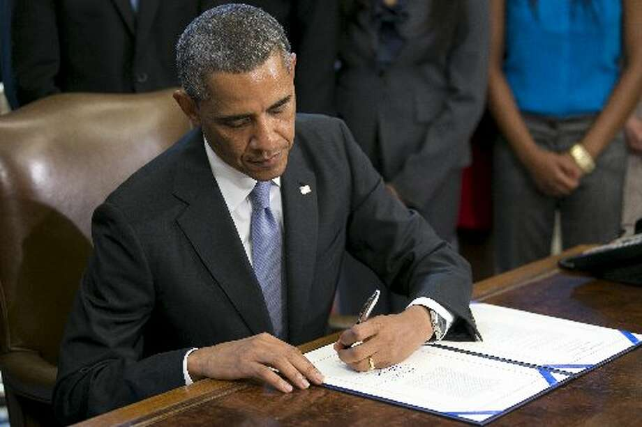 Barack Obama signs college loan legislation - with his left hand. Obama is the latest in the string of left-handed presidents, including George W. Photo: Bloomberg