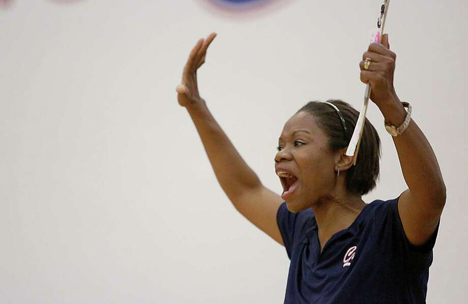 8/13/13: Clear Lake Falcons head coach Chanda Eager pumps up her fist after Clear Lake took the lead in game 5 against the Friendswood Mustangs  in a high school volleyball match at Clear Lake High School in Houston, Texas. Photo: Thomas B. Shea, For The Chronicle / © 2013 Thomas B. Shea