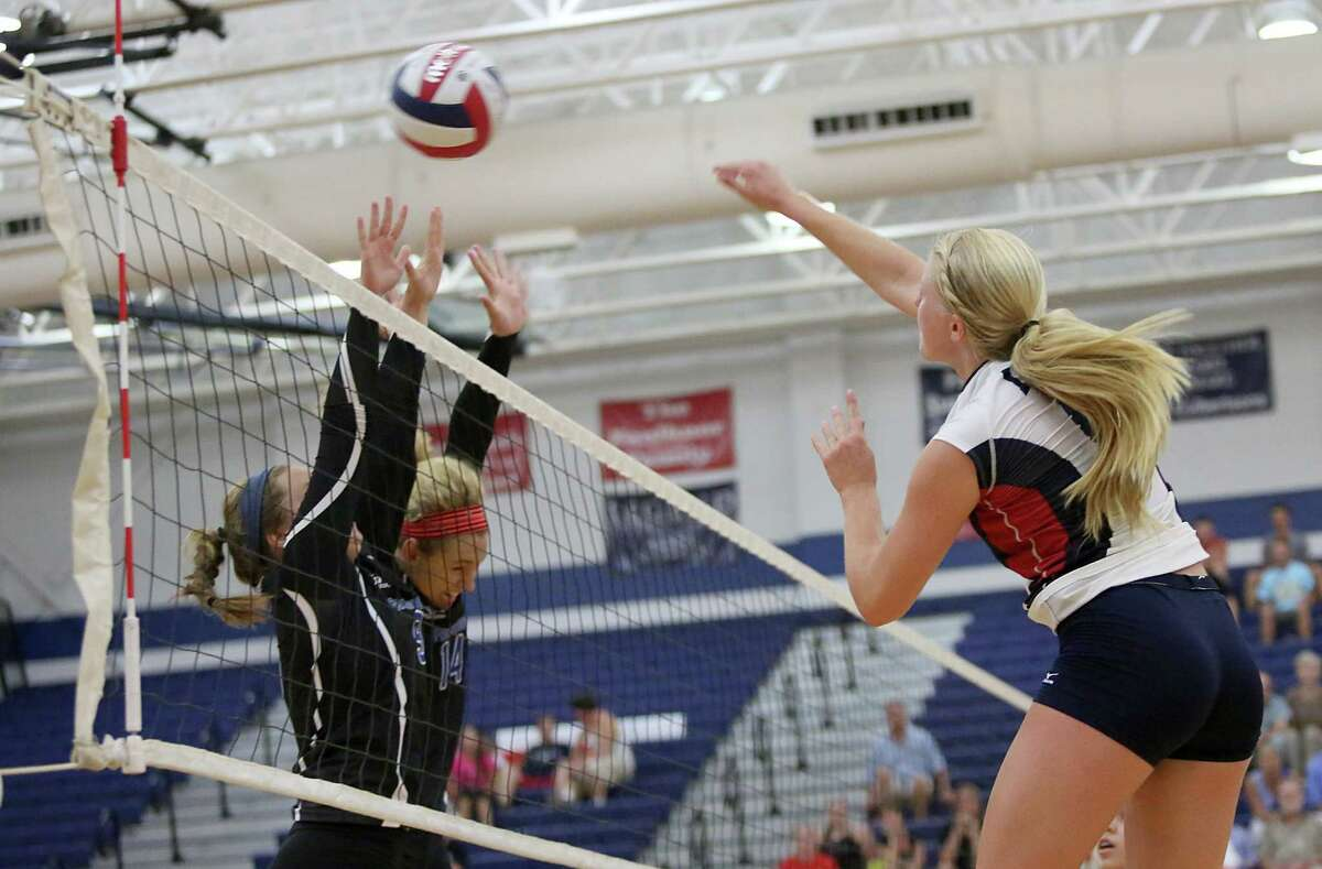 8/13/13: Clear Lake Falcons Megan Rasmussen #6 spikes the ball for a point against the Friendswood Mustangs player in a high school volleyball match in game 5 at Clear Lake High School in Houston, Texas. Clear Lake won 3 games to 2.