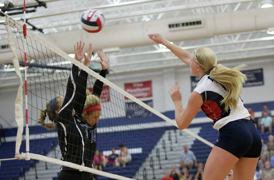 8/13/13: Clear Lake Falcons Megan Rasmussen #6 spikes the ball for a point against the Friendswood Mustangs  player in a high school volleyball match in game 5 at Clear Lake High School in Houston, Texas. Clear Lake won 3 games to 2. Photo: Thomas B. Shea, For The Chronicle / © 2013 Thomas B. Shea
