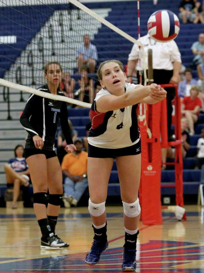 8/13/13: Clear Lake Falcons Ty Reeves #4 makes a dig against the Friendswood Mustangs in game 5  in a high school volleyball match at Clear Lake High School in Houston, Texas. Clear Lake won 3 games to 2. Photo: Thomas B. Shea, For The Chronicle / © 2013 Thomas B. Shea