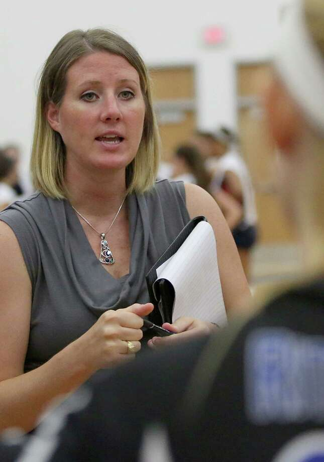 8/13/13: Friendswood Mustangs head coach Kelly Beck talks to her team before game 5 against the Clear Lake Falcons in a high school volleyball match at Clear Lake High School in Houston, Texas. Photo: Thomas B. Shea, For The Chronicle / © 2013 Thomas B. Shea