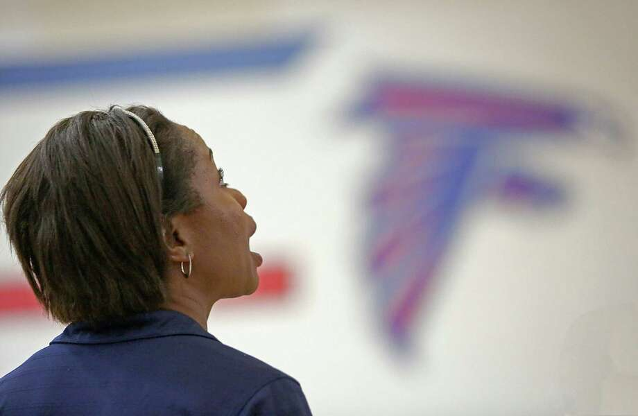 8/13/13: Clear Lake Falcons head coach Chanda Eager looks at the power outage during game 5 against the Friendswood Mustangs  in a high school volleyball match at Clear Lake High School in Houston, Texas. Photo: Thomas B. Shea, For The Chronicle / © 2013 Thomas B. Shea