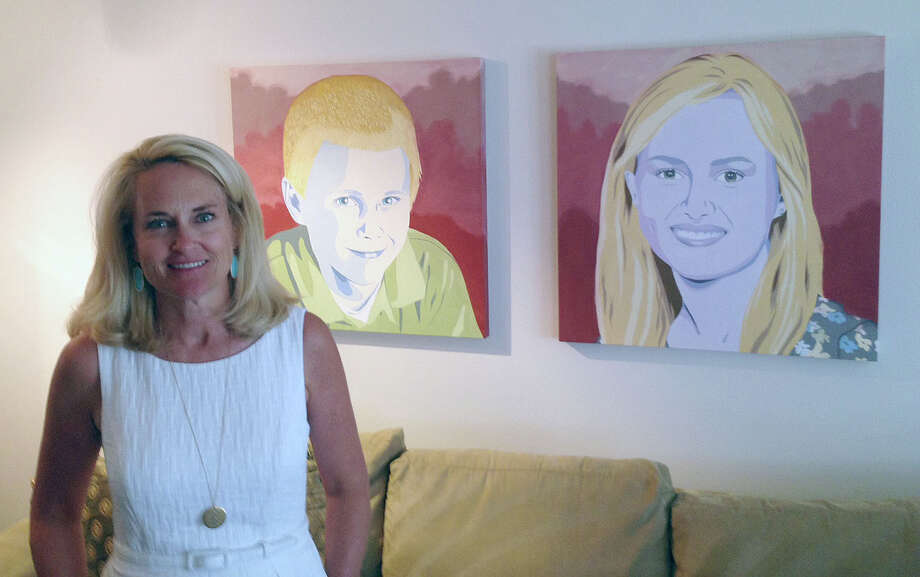 Barbara Holdsworth with paintings of her two children. Holdsworth was severely injured in a shooting last summer near Texas A&M in which a constable and another man were killed. Photo: Mike Glenn / Houston Chronicle