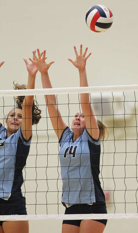 Johnson's Kylie Rittimann (14) is out of the reach of a block against Clark in volleyball at Littleton Gym on Tuesday, Aug. 13, 2013. Photo: Kin Man Hui, San Antonio Express-News / ©2013 San Antonio Express-News
