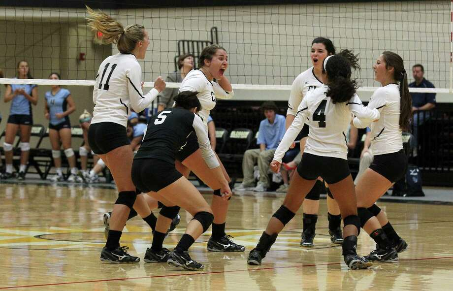 The Clark Cougars celebrate after winning the third game against Johnson in volleyball at Littleton Gym on Tuesday, Aug. 13, 2013. Photo: Kin Man Hui, San Antonio Express-News / ©2013 San Antonio Express-News