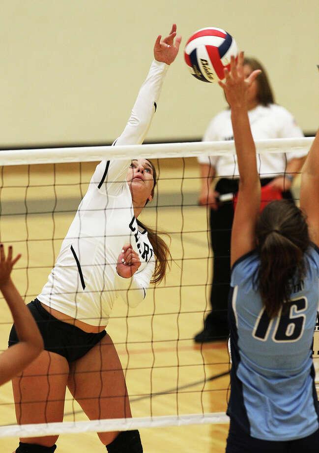 Clark's Megan Pattison (17) hits against Johnson's Lauren Bault (16) in volleyball at Littleton Gym on Tuesday, Aug. 13, 2013. Photo: Kin Man Hui, San Antonio Express-News / ©2013 San Antonio Express-News