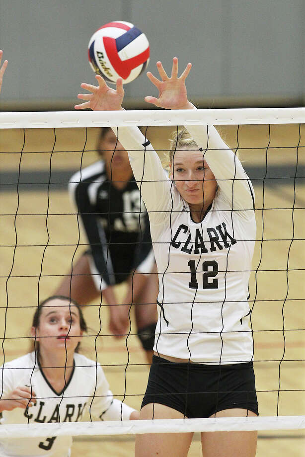 Clark's Kim Gillette (12) just misses a block against Johnson in volleyball at Littleton Gym on Tuesday, Aug. 13, 2013. Photo: Kin Man Hui, San Antonio Express-News / ©2013 San Antonio Express-News
