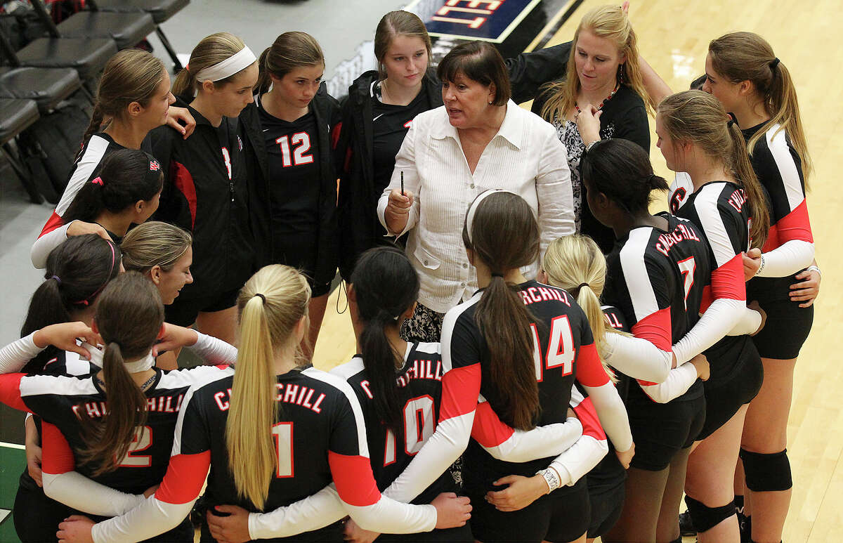 Churchill coach Jo Anne Hultgren huddles her team during their game against Warren in volleyball at Littleton Gym on Tuesday, Aug. 13, 2013.