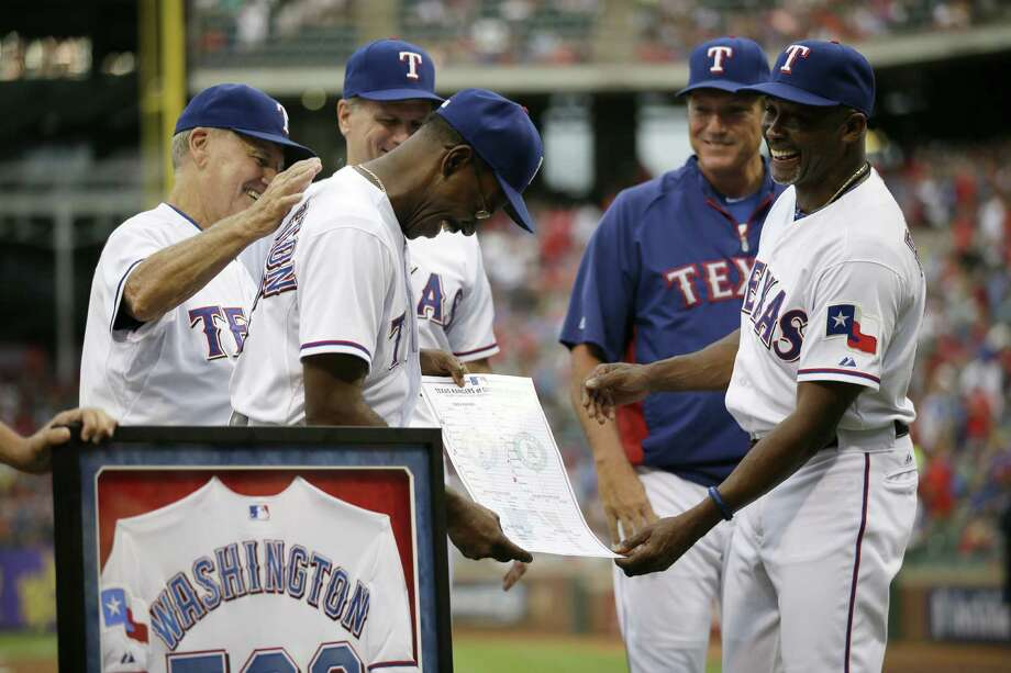 Texas coaches present manager Ron Washington with the lineup card from a recent victory that made him the winningest skipper in team history. The Rangers then lost to the Brewers in Arlington. Photo: Tony Gutierrez / Associated Press