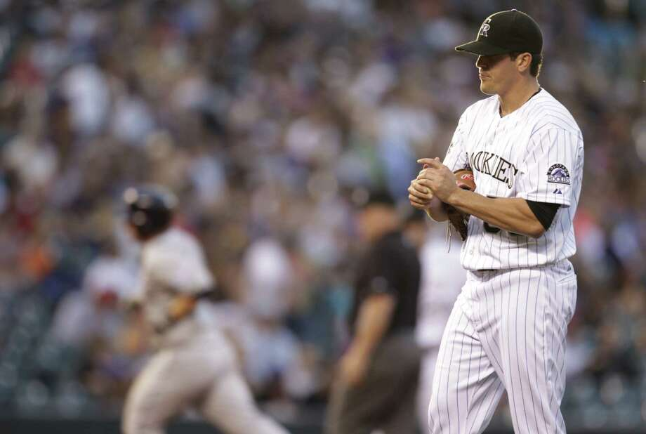Rockies pitcher Jeff Manship, a former Reagan star, rubs the baseball after giving up a solo homer to the Padres' Jedd Gyorko in the third inning. Photo: Joe Mahoney / Associated Press