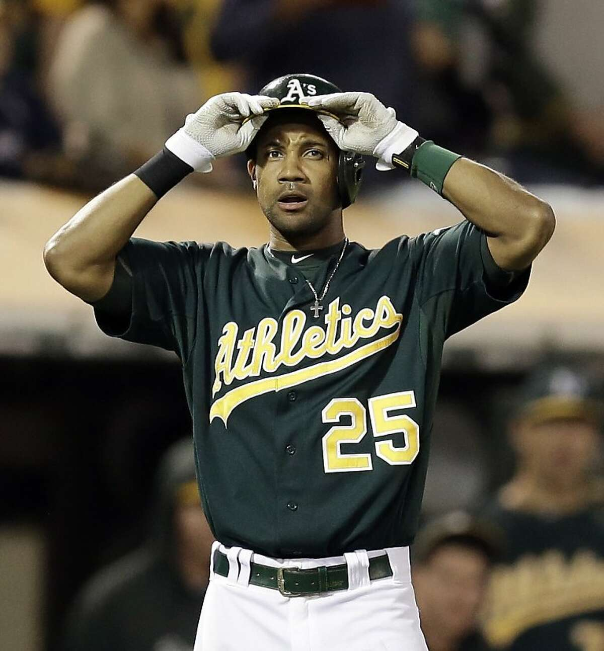 Oakland Athletics' Chris Young reacts after a ball he hit that would have won the game was ruled foul after review in the ninth inning of a baseball game against the Houston Astros Tuesday, Aug. 13, 2013, in Oakland, Calif. (AP Photo/Ben Margot)
