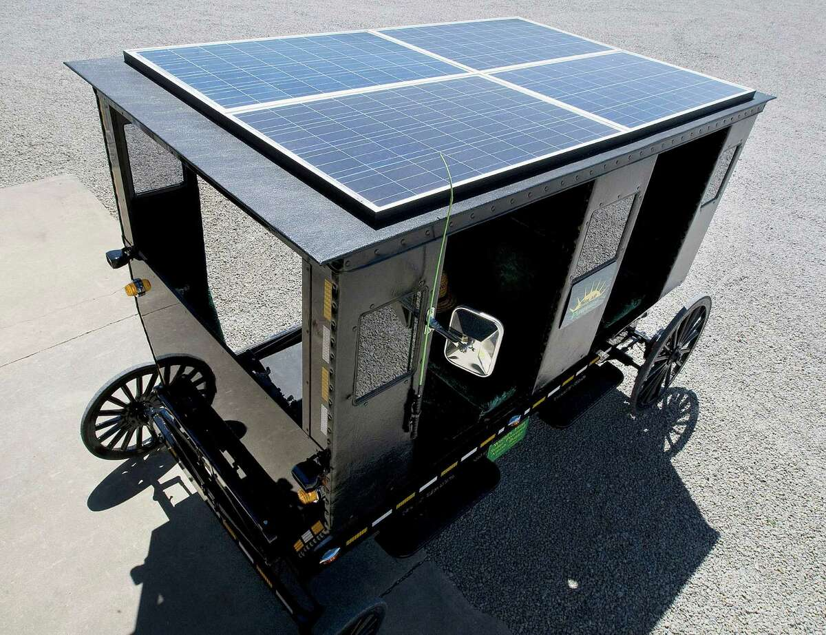 In this July 24, 2013 photo, Larry Yoder constructed this solar-powered Amish buggy in Sullivan, Ill. Yoder took a former Amish buggy and built solar panels into the roof to feed batteries that power an electric motor capable of whipping it along at 14 mph, flat out.