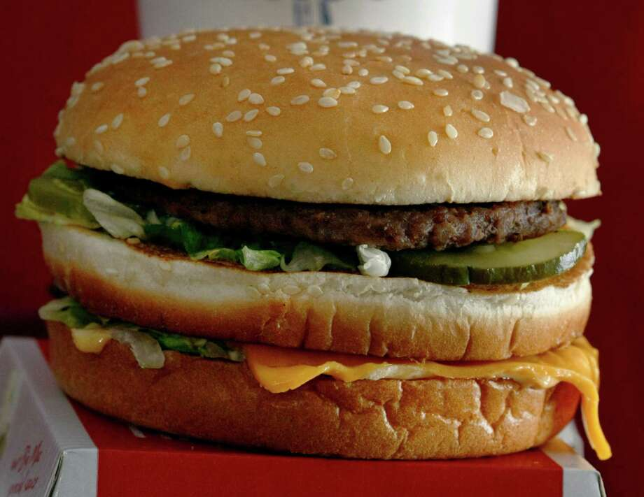 McDonald's Big Mac, 550 calories.-One Big Mac Contains 45 percent of your total fat limit for the day and about half of the 20 grams of saturated fat you should limit yourself to each day on a 2,000-calorie diet. Photo: Keith Srakocic, Associated Press / AP