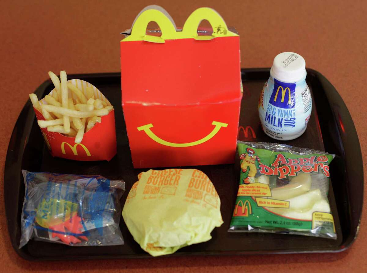 McDonald's Happy Meal (with cheeseburger, fries, apple slices and 1% milk), 535 calories.