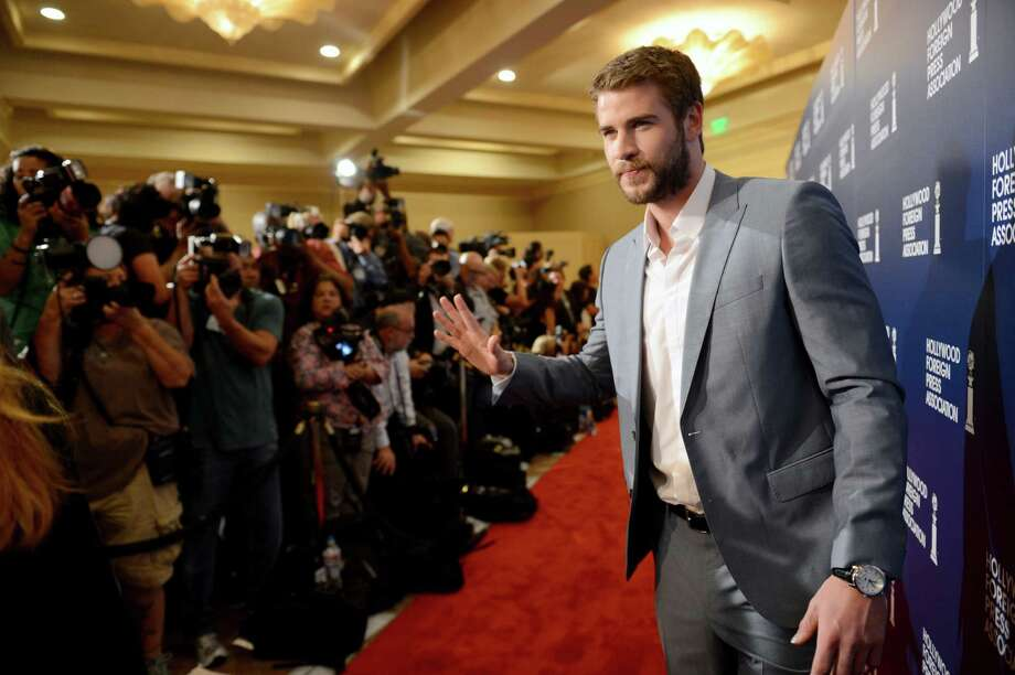 Liam Hemsworth arrives at the Hollywood Foreign Press Association Luncheon at the Beverly Hilton Hotel on Tuesday, Aug. 13, 2013, in Beverly Hills, Calif. (Photo by Jordan Strauss/Invision/AP) ORG XMIT: CAPM132 Photo: Jordan Strauss, AP / Invision
