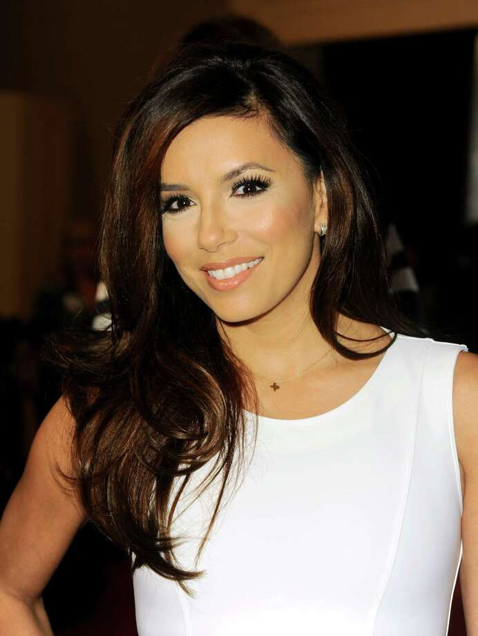 Eva Longoria arrives at the Hollywood Foreign Press Association Luncheon at the Beverly Hilton Hotel on Tuesday, Aug. 13, 2013, in Beverly Hills, Calif. (Photo by Jordan Strauss/Invision/AP) ORG XMIT: CAPM119 Photo: Jordan Strauss, AP / Invision