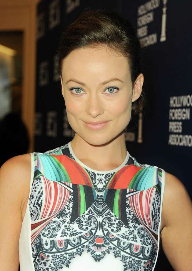 Olivia Wilde arrives at the Hollywood Foreign Press Association Luncheon at the Beverly Hilton Hotel on Tuesday, Aug. 13, 2013, in Beverly Hills, Calif. (Photo by Jordan Strauss/Invision/AP) ORG XMIT: CAPM107 Photo: Jordan Strauss, AP / Invision