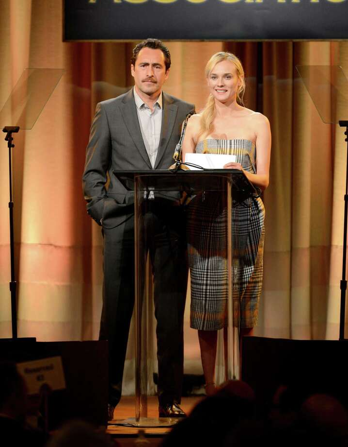 Demian Bichir, left, and Diane Kruger speak on stage at the Hollywood Foreign Press Association Luncheon at the Beverly Hilton Hotel on Tuesday, Aug. 13, 2013, in Beverly Hills, Calif. (Photo by Chris Pizzello/Invision/AP) ORG XMIT: CAPM138 Photo: Chris Pizzello, AP / Invision