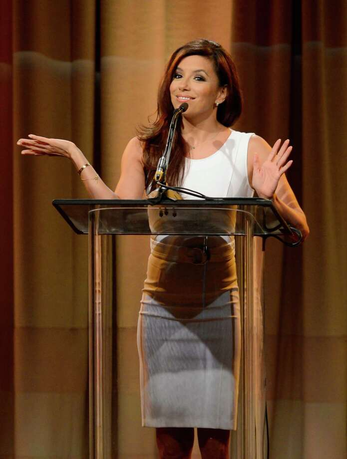 Eva Longoria speaks on stage at the Hollywood Foreign Press Association Luncheon at the Beverly Hilton Hotel on Tuesday, Aug. 13, 2013, in Beverly Hills, Calif. (Photo by Chris Pizzello/Invision/AP) ORG XMIT: CAPM147 Photo: Chris Pizzello, AP / Invision