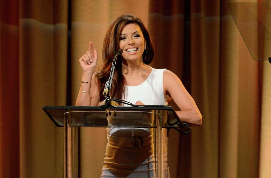 Eva Longoria speaks on stage at the Hollywood Foreign Press Association Luncheon at the Beverly Hilton Hotel on Tuesday, Aug. 13, 2013, in Beverly Hills, Calif. (Photo by Chris Pizzello/Invision/AP) ORG XMIT: CAPM146 Photo: Chris Pizzello, AP / Invision