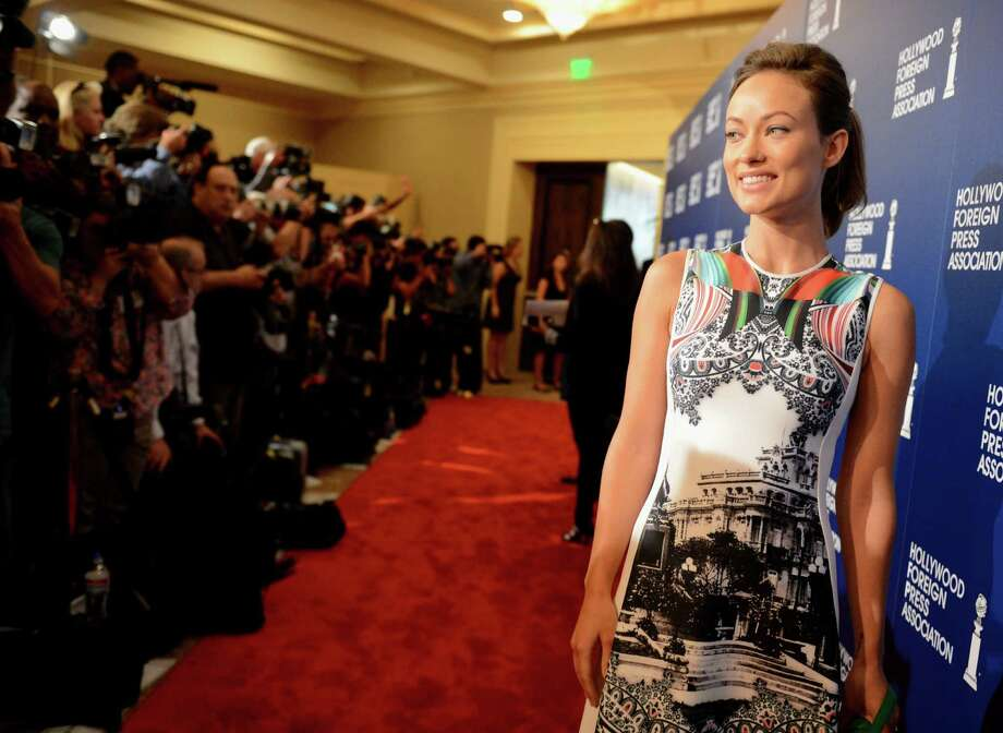 Olivia Wilde arrives at the Hollywood Foreign Press Association Luncheon at the Beverly Hilton Hotel on Tuesday, Aug. 13, 2013, in Beverly Hills, Calif. (Photo by Jordan Strauss/Invision/AP) ORG XMIT: CAPM125 Photo: Jordan Strauss, AP / Invision