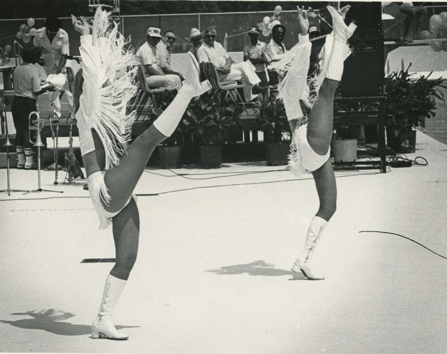 Derrick Dolls Mollie Roe and Myrna Santos practice their kicks before a performance for the Sharpstown Pool Dedication and Splash Day Ceremony in 1982. Photo: Dan Hardy, Houston Chronicle Files