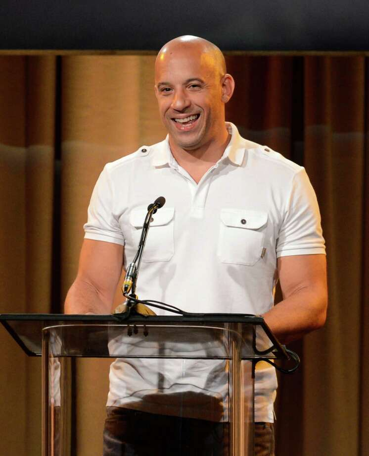 Vin Diesel speaks on stage at the Hollywood Foreign Press Association Luncheon at the Beverly Hilton Hotel on Tuesday, Aug. 13, 2013, in Beverly Hills, Calif. (Photo by Chris Pizzello/Invision/AP) ORG XMIT: CAPM143 Photo: Chris Pizzello, AP / Invision
