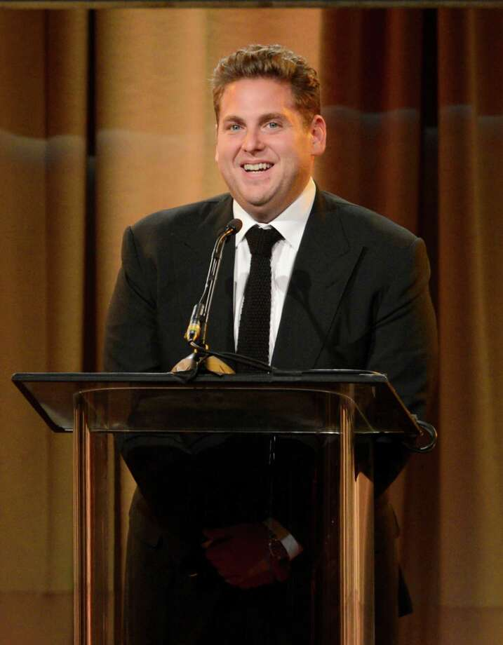 Jonah Hill speaks on stage at the Hollywood Foreign Press Association Luncheon at the Beverly Hilton Hotel on Tuesday, Aug. 13, 2013, in Beverly Hills, Calif. (Photo by Chris Pizzello/Invision/AP) ORG XMIT: CAPM150 Photo: Chris Pizzello, AP / Invision