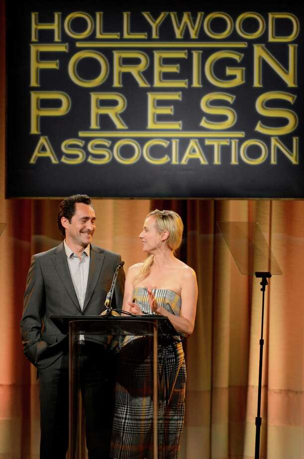 Demian Bichir, left, and Diane Kruger speak on stage at the Hollywood Foreign Press Association Luncheon at the Beverly Hilton Hotel on Tuesday, Aug. 13, 2013, in Beverly Hills, Calif. (Photo by Chris Pizzello/Invision/AP) ORG XMIT: CAPM140 Photo: Chris Pizzello, AP / Invision
