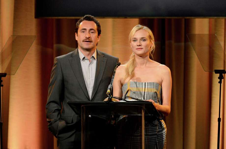 Demian Bichir, left, and Diane Kruger speak on stage at the Hollywood Foreign Press Association Luncheon at the Beverly Hilton Hotel on Tuesday, Aug. 13, 2013, in Beverly Hills, Calif. (Photo by Chris Pizzello/Invision/AP) ORG XMIT: CAPM139 Photo: Chris Pizzello, AP / Invision