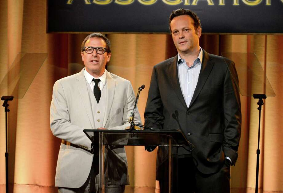 David O. Russell, left, and Vince Vaughn speak on stage at the Hollywood Foreign Press Association Luncheon at the Beverly Hilton Hotel on Tuesday, Aug. 13, 2013, in Beverly Hills, Calif. (Photo by Chris Pizzello/Invision/AP) ORG XMIT: CAPM142 Photo: Chris Pizzello, AP / Invision