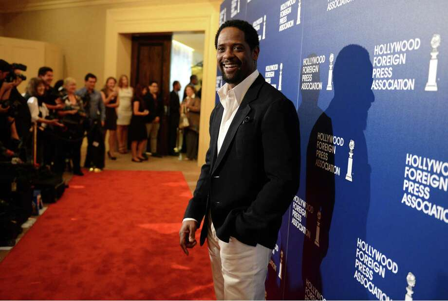 Blair Underwood arrives at the Hollywood Foreign Press Association Luncheon at the Beverly Hilton Hotel on Tuesday, Aug. 13, 2013, in Beverly Hills, Calif. (Photo by Jordan Strauss/Invision/AP) ORG XMIT: CAPM116 Photo: Jordan Strauss, AP / Invision