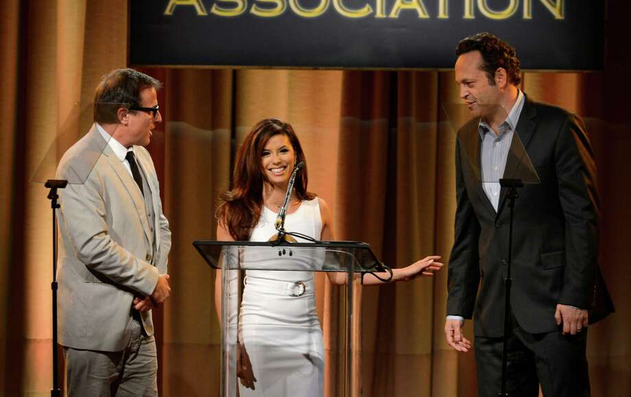From left, David O. Russell, Eva Longoria and Vince Vaughn speak on stage at the Hollywood Foreign Press Association Luncheon at the Beverly Hilton Hotel on Tuesday, Aug. 13, 2013, in Beverly Hills, Calif. (Photo by Chris Pizzello/Invision/AP) ORG XMIT: CAPM142 Photo: Chris Pizzello, AP / Invision