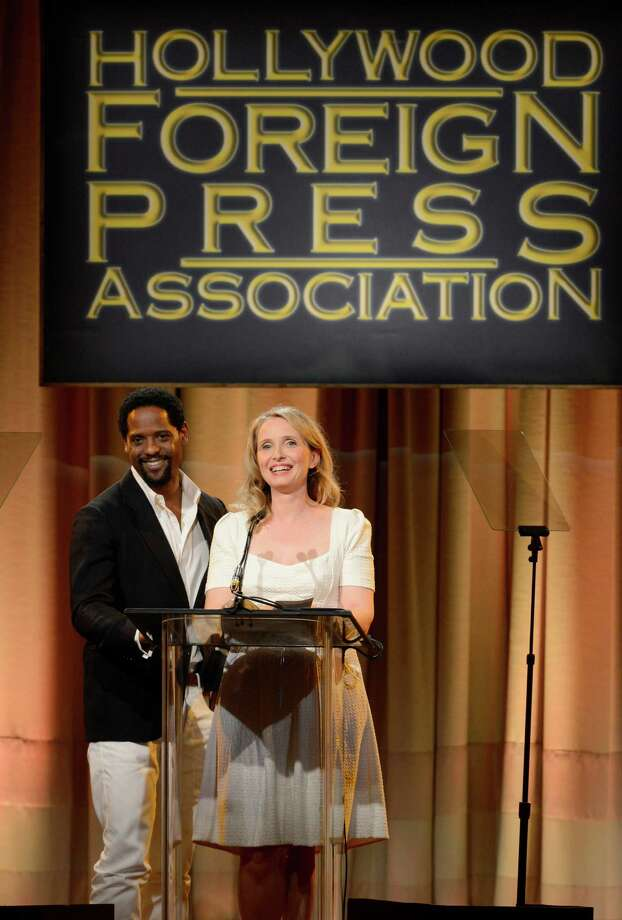 Blair Underwood, left, and Julie Delpy speak on stage at the Hollywood Foreign Press Association Luncheon at the Beverly Hilton Hotel on Tuesday, Aug. 13, 2013, in Beverly Hills, Calif. (Photo by Chris Pizzello/Invision/AP) ORG XMIT: CAPM144 Photo: Chris Pizzello, AP / Invision