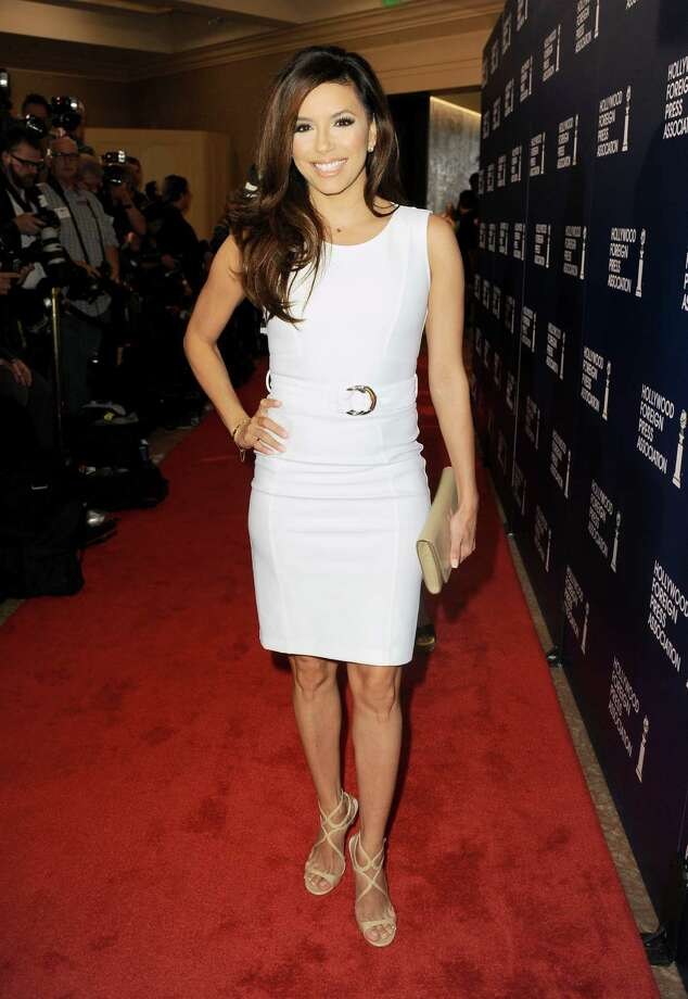 Eva Longoria arrives at the Hollywood Foreign Press Association Luncheon at the Beverly Hilton Hotel on Tuesday, Aug. 13, 2013, in Beverly Hills, Calif. (Photo by Jordan Strauss/Invision/AP) ORG XMIT: CAPM124 Photo: Jordan Strauss, AP / Invision