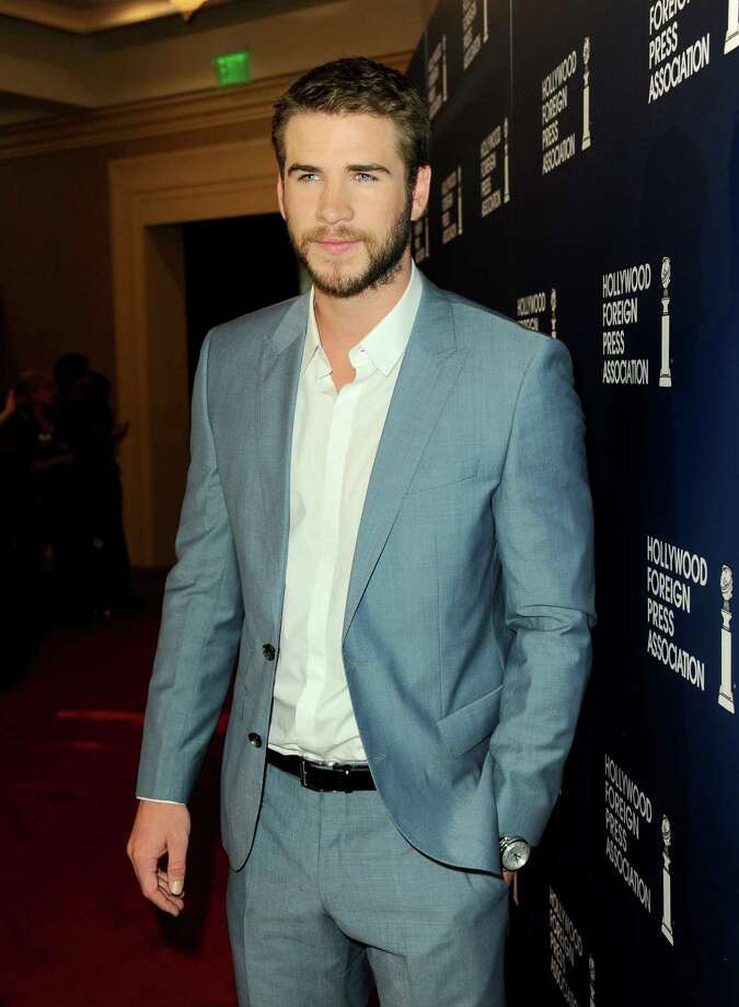 Liam Hemsworth arrives at the Hollywood Foreign Press Association Luncheon at the Beverly Hilton Hotel on Tuesday, Aug. 13, 2013, in Beverly Hills, Calif. (Photo by Jordan Strauss/Invision/AP) ORG XMIT: CAPM123 Photo: Jordan Strauss, AP / Invision
