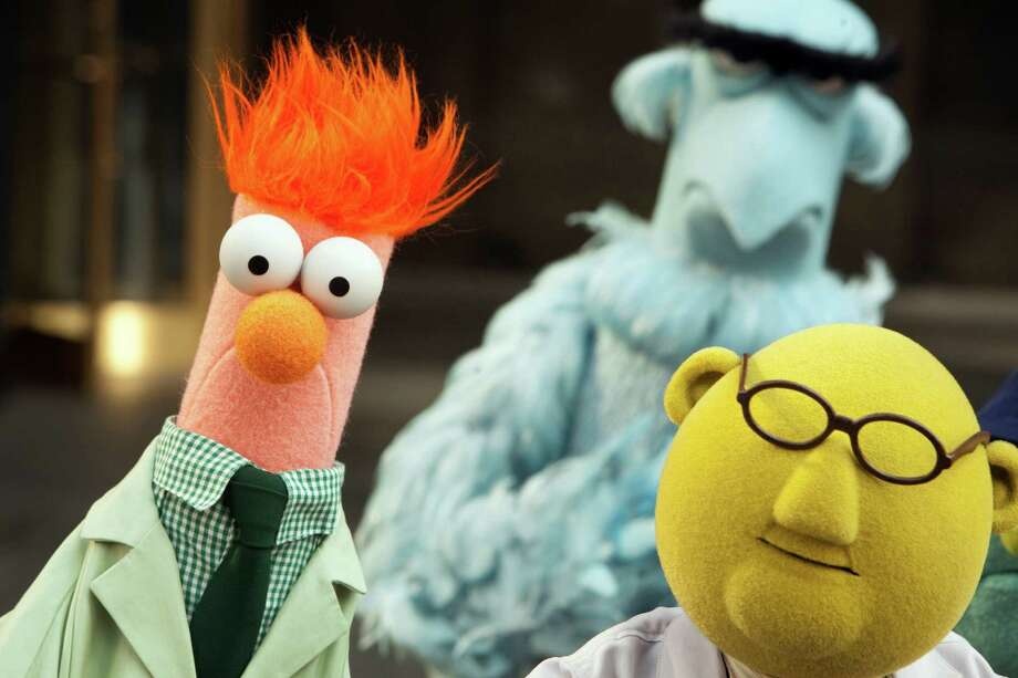 Even Muppets are bald! Both Dr. Bunsen Honeydew (right) and Sam the Eagle (back) are hairless, unless you count Sam's magnificent uni-brow. Beaker is the odd man out with his long, flaming-red locks.   Photo: Scott Garfield / ©2011 Disney Enterprises, Inc. All Rights Reserved.