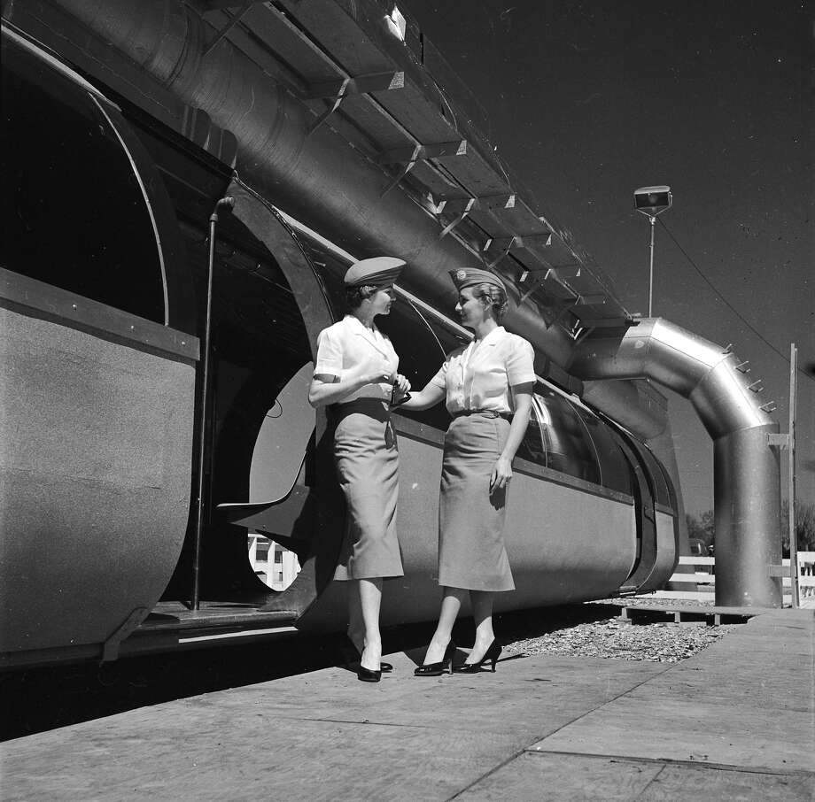 circa 1950:  Two hostesses stand in front of a new monorail service in Houston, Texas. Photo: Evans, Getty Images / Hulton Archive