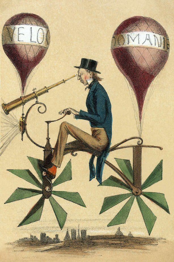 """UNSPECIFIED - CIRCA 1867:  French cartoon shows a man riding on a bicycle-like flying machine while looking through a telescope attached to the front. Two balloons, """"Velocipedes]"""" and """"Domanie,"""" are attached at front and rear as are propeller-like wheels. Photo: Buyenlarge, Getty Images / Archive Photos"""