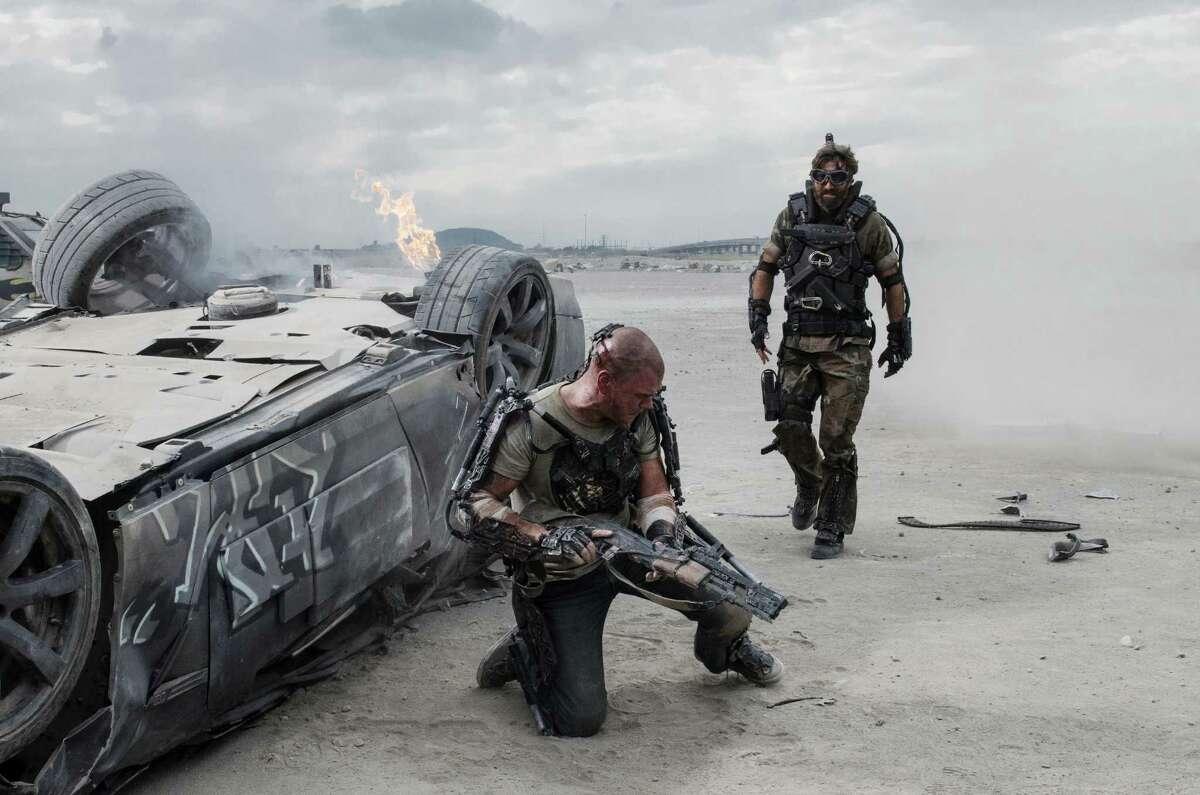 Matt Damon (left) and Sharlto Copley in Columbia Pictures' ELYSIUM.