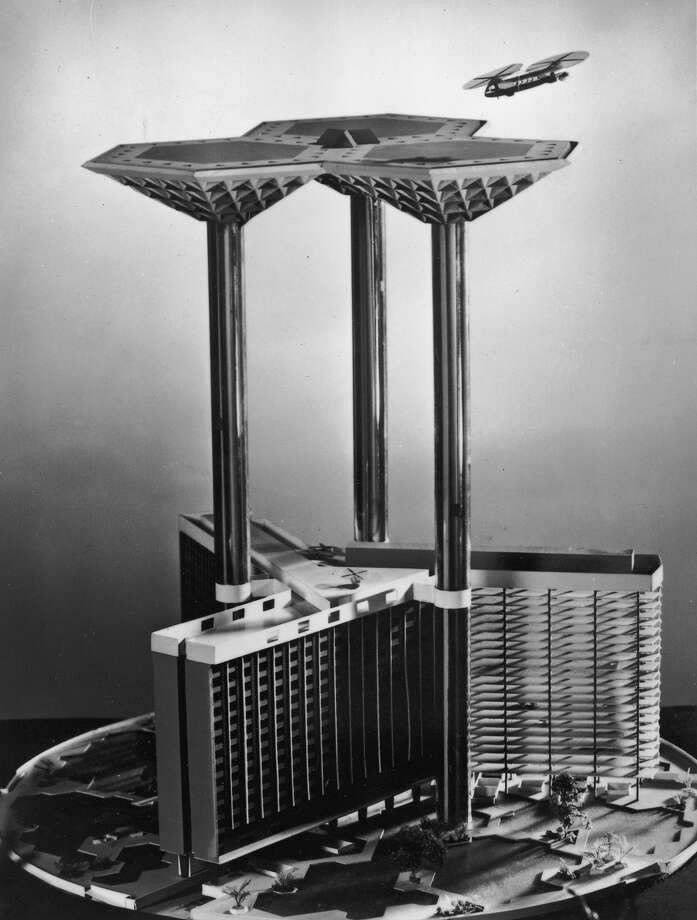 1957: An architect's model of 'Skyport 2000', a futuristic proposal for an airport building to stand in St George's Circus, near Waterloo Station, London in the year 2000. Made for the Glass Age Development Committee and designed by architect James Dartford, the model shows how aircraft could land and take off from a giant platform supported by three glass-clad pillars. These would contain lifts carrying passengers down to a hotel, offices, and parking for private planes and cars. Photo: Keystone, Getty Images / Hulton Archive