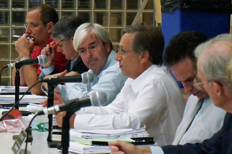 Members of the Town Plan and Zoning Commission listen to speakers debate a proposal to change residential lot frontage requirements at Tuesday's meeting. Photo: Genevieve Reilly / Fairfield Citizen
