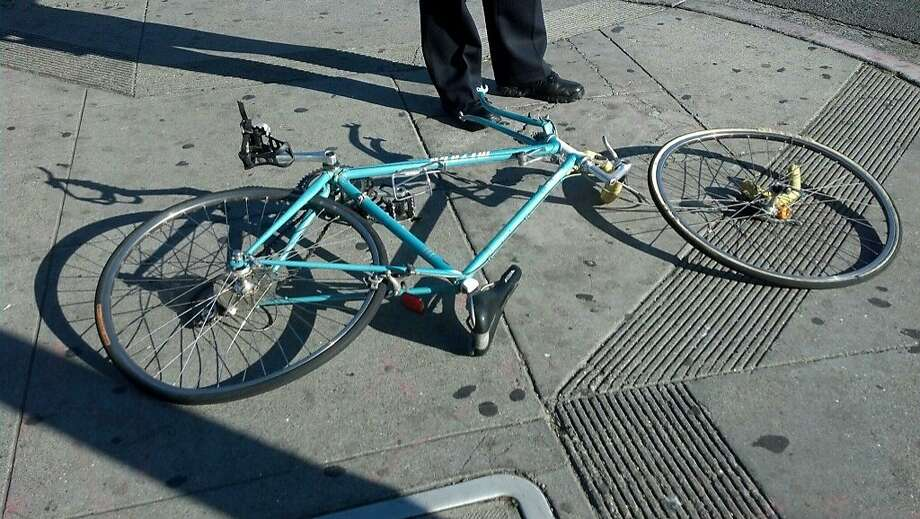 The woman's bicycle remained at the scene after the crash at Sixth and Folsom streets Wednesday morning. The bicyclist, whose name was not released, died at San Francisco General Hospital after colliding with a truck. Photo: Courtesy, Will Tran