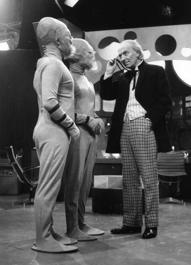 William Hartnell, the first Dr Who (1963 to 1966), peers through his monocle at two extra-terrestrials during filming of the popular science fiction series, 'Dr Who' at the BBC's Shepherds Bush Studios in London.   (Photo by Harry Todd/Getty Images) Photo: Harry Todd, Getty Images / Hulton Archive