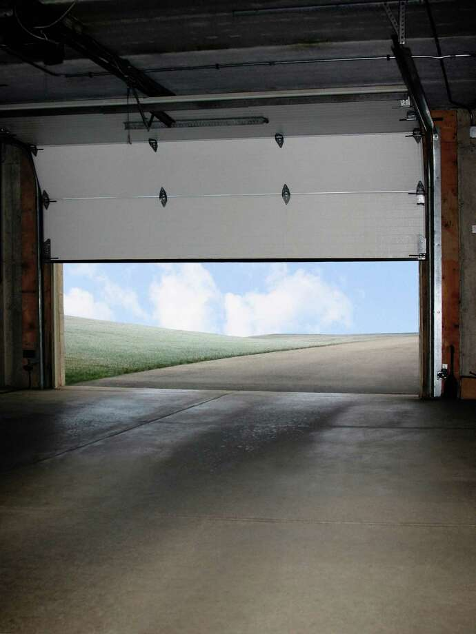 """I Can't Get My Car Out of the Garage: This is another one that Mobley didn't buy. An employee said that a power failure was preventing him from opening his power-operated garage door. """"I reminded him that there's a pull chain on it for just such cases,"""" she says. Photo: Steven Puetzer, Getty Images / (c) Steven Puetzer"""